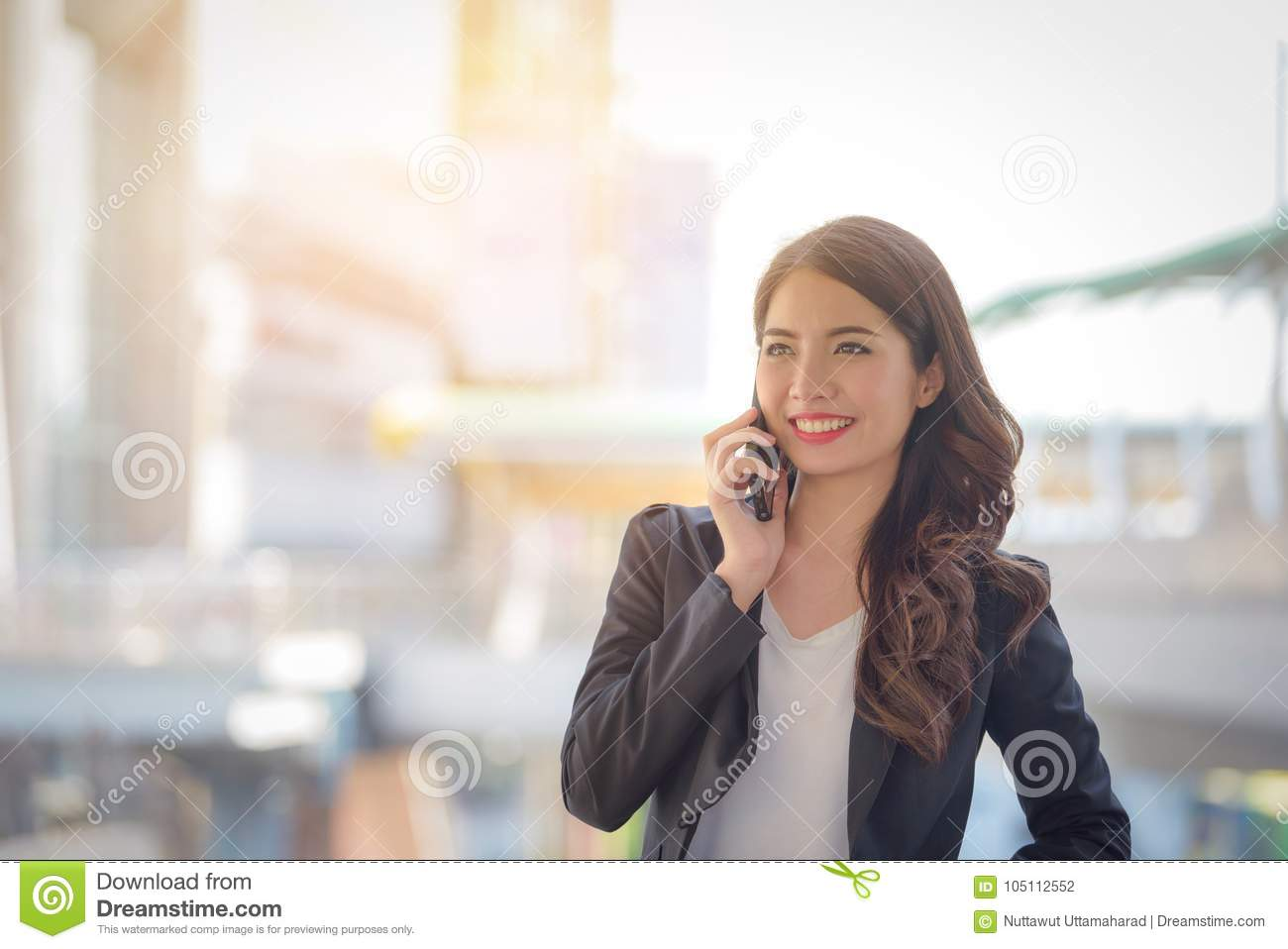 Portrait of business woman happy smile talking on smartphone wit