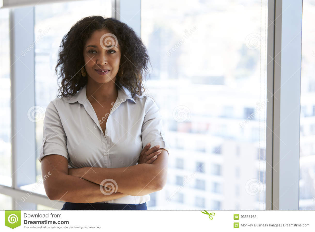 Download Portrait Of Businesswoman Standing By Window In Office Stock Photo - Image of business, confident: 93536162