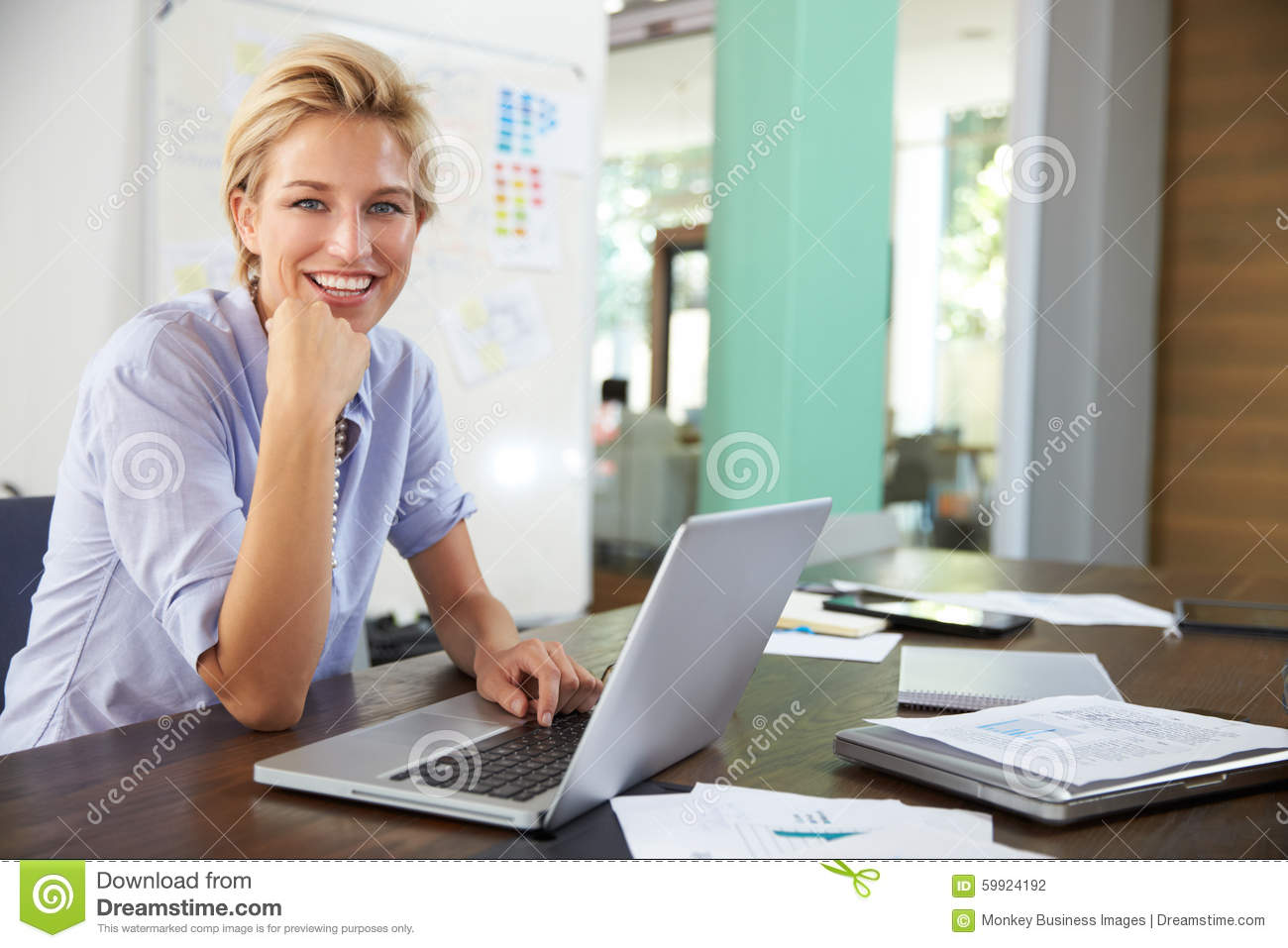 Portrait of businesswoman working in creative office stock for Office photo