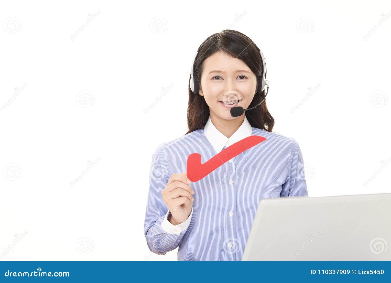 Call center operator with a check mark