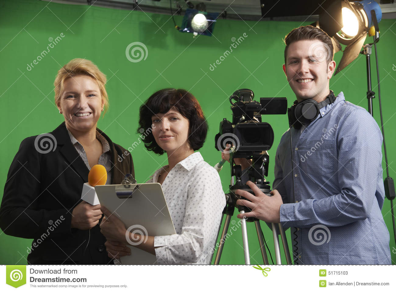 Portrait Of Cameraman With Presenter And Floor Manager In