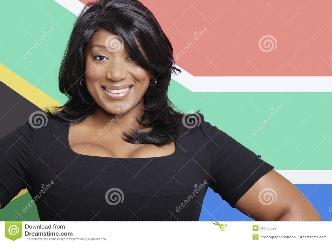 Portrait of casual mixed race woman against South African flag