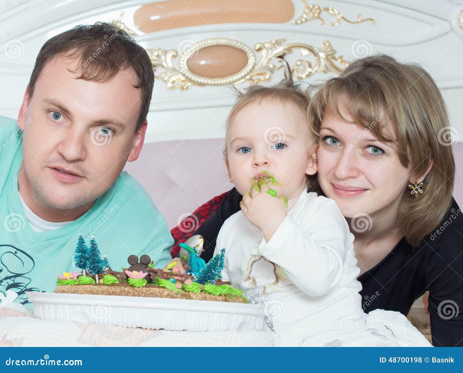 Portrait of caucasian family on happy birthday with cake