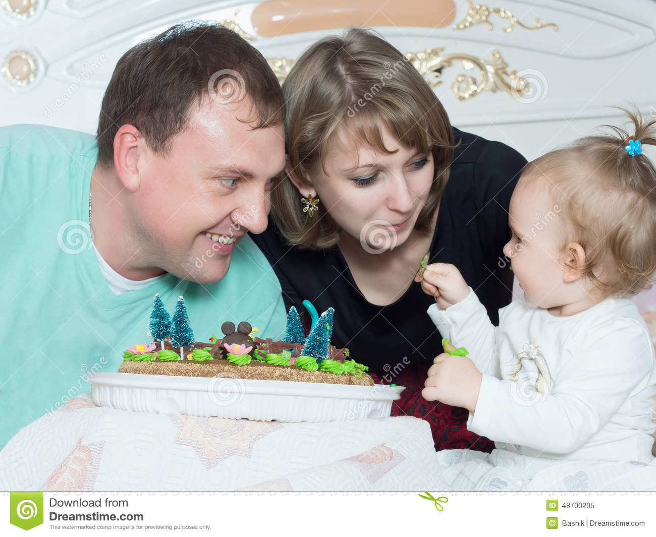 Portrait of caucasian family on happy birthday with cake