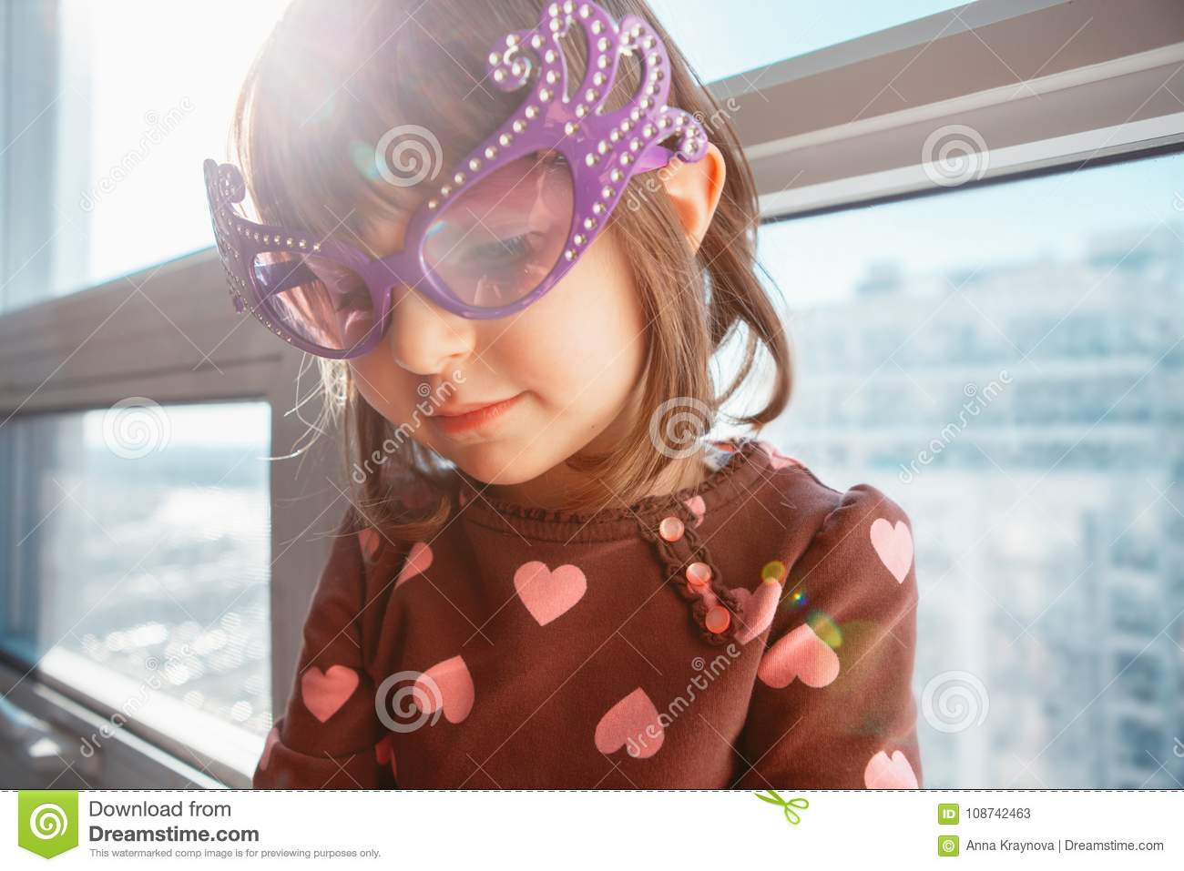 Portrait of Caucasian girl chil with funny glasses