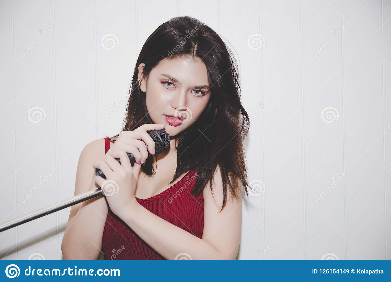 Portrait charming beautiful woman. Attractive girl sing a song