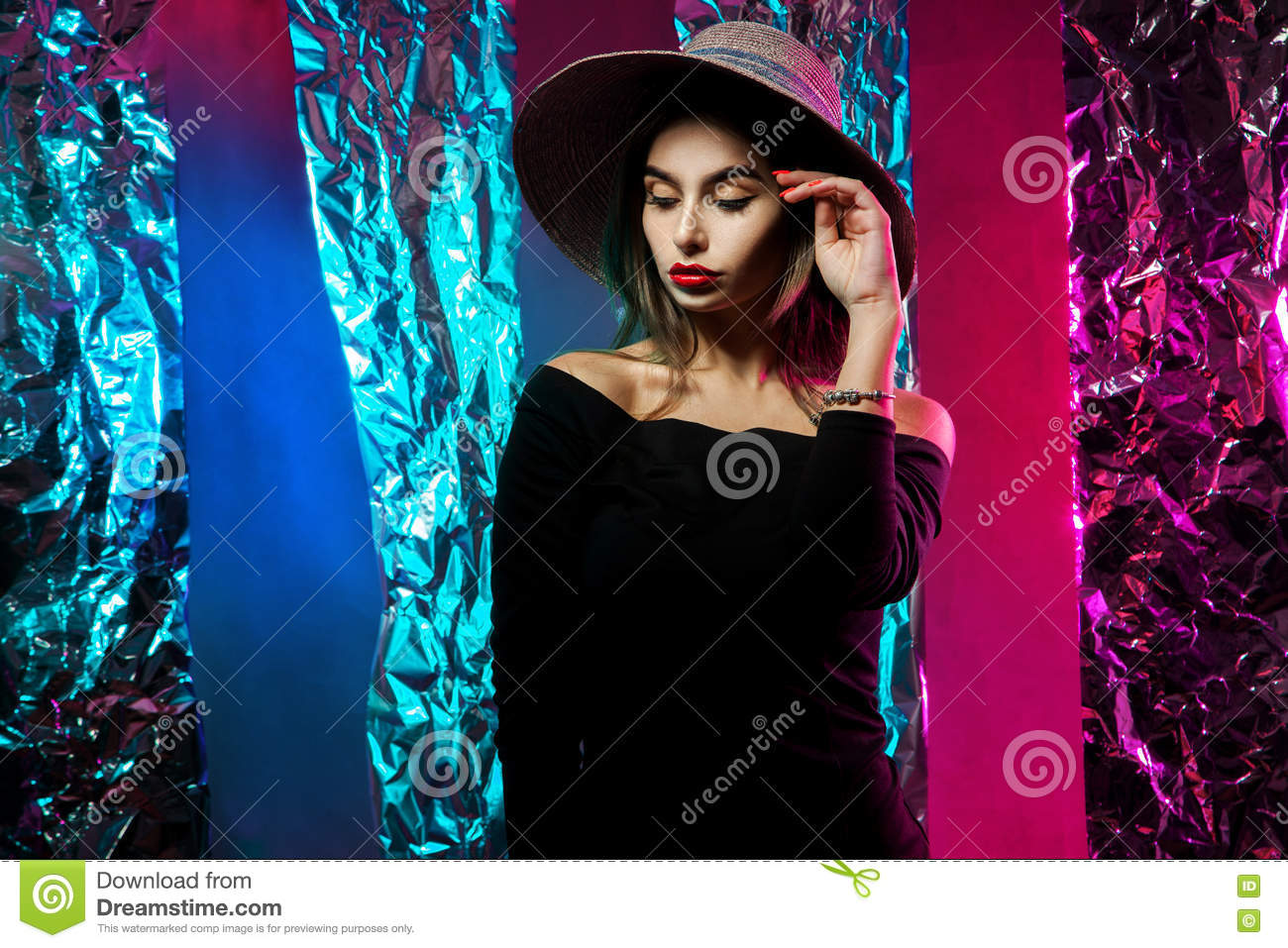 Portrait of charming young girl in hat with wide brim