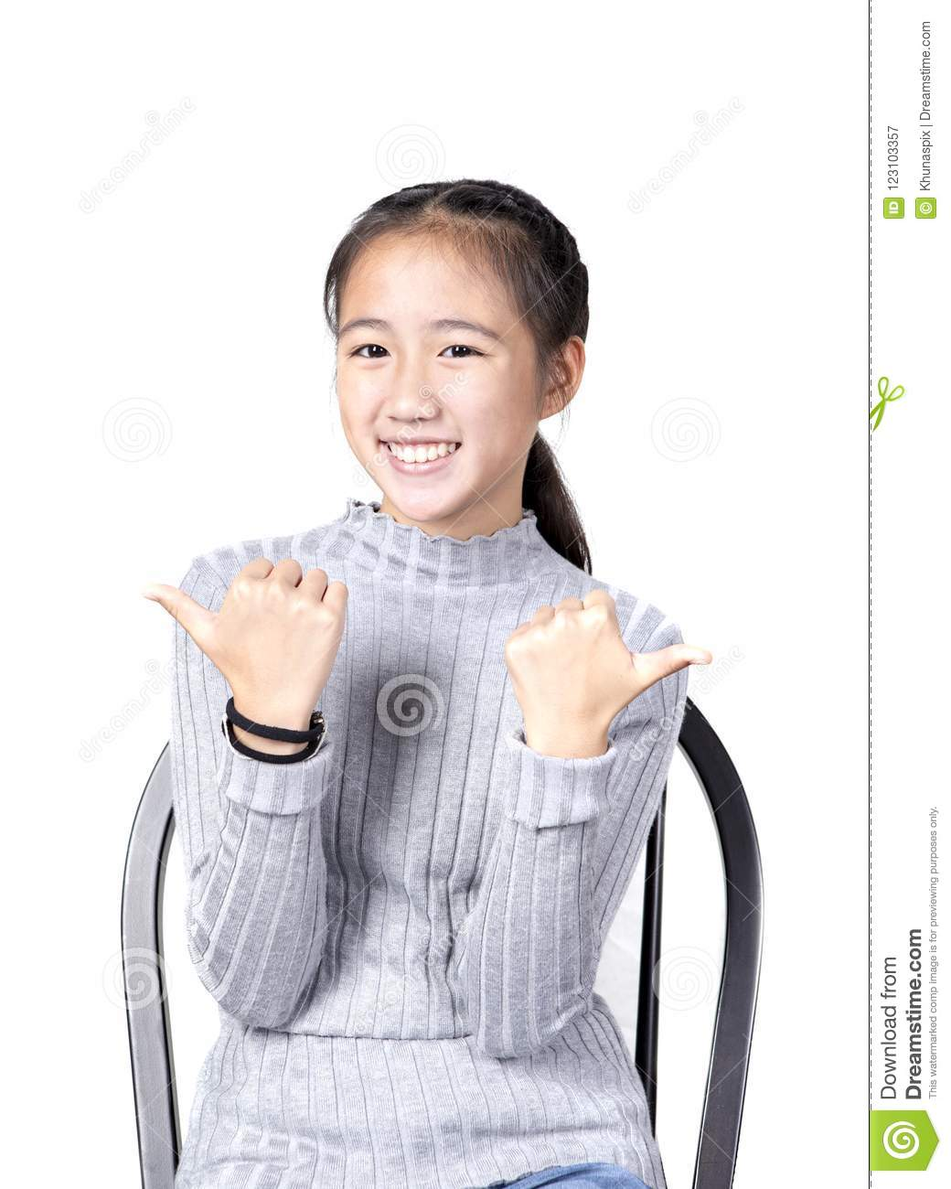 Portrait of cheerful asian teenager toothy smiling face on white