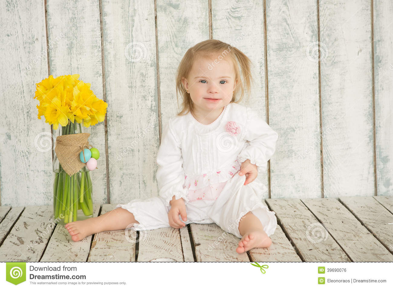 Portrait Of Cheerful Baby Girl With Down Syndrome Stock