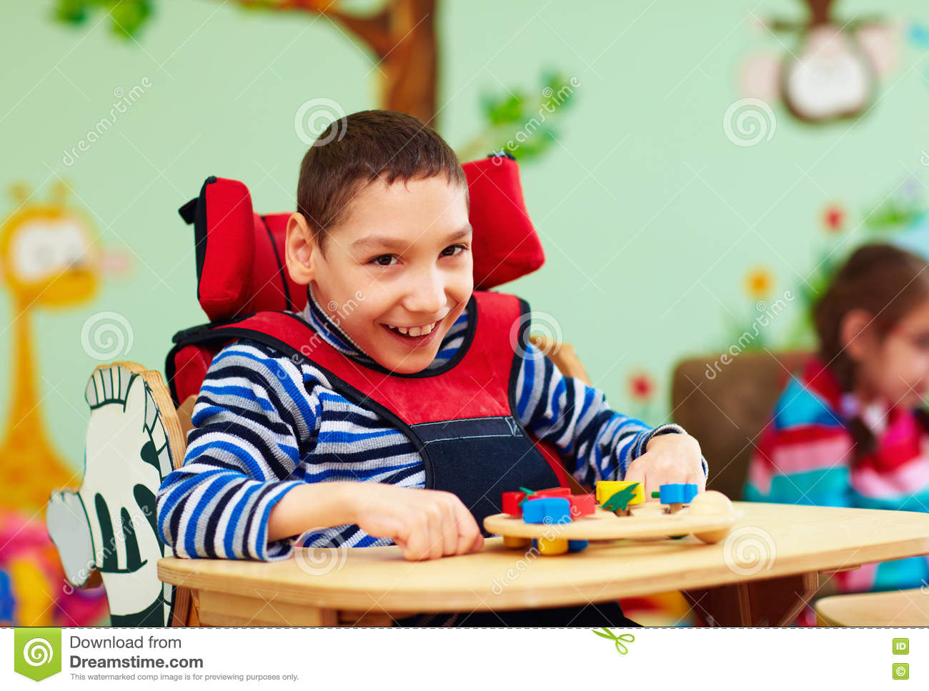 Portrait of cheerful boy with disability at rehabilitation center for kids with special needs