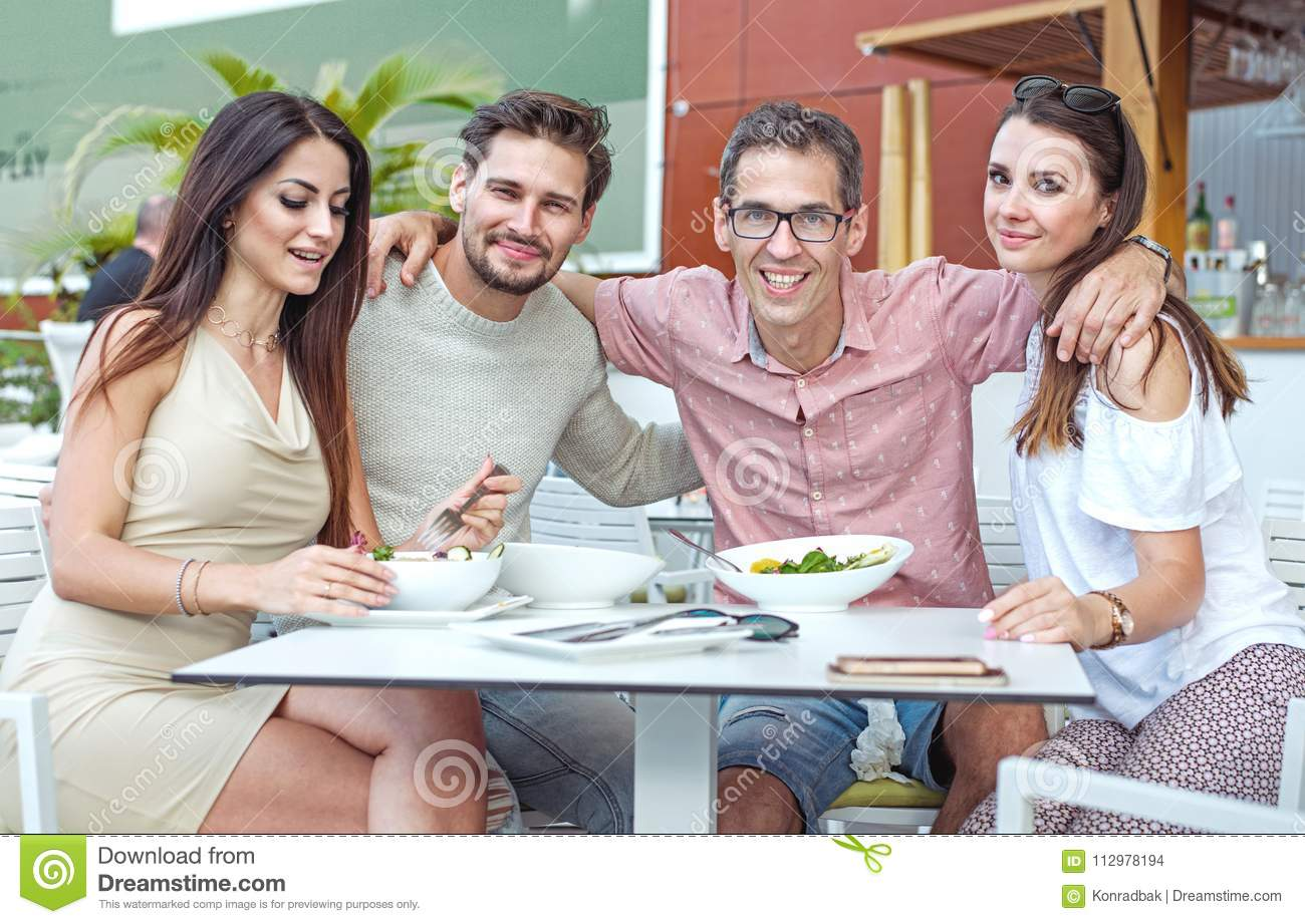Portrait of cheerful freinds in the summer restaurant