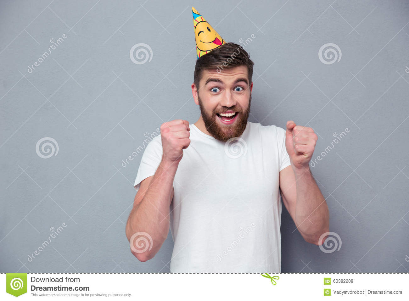 Portrait of a cheerful man with birthday hat
