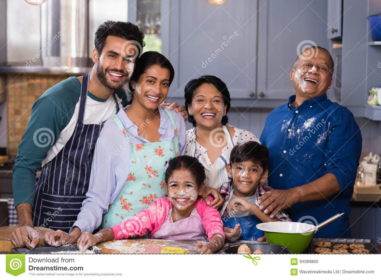 Portrait of cheerful multi-generation family enjoying in kitchen