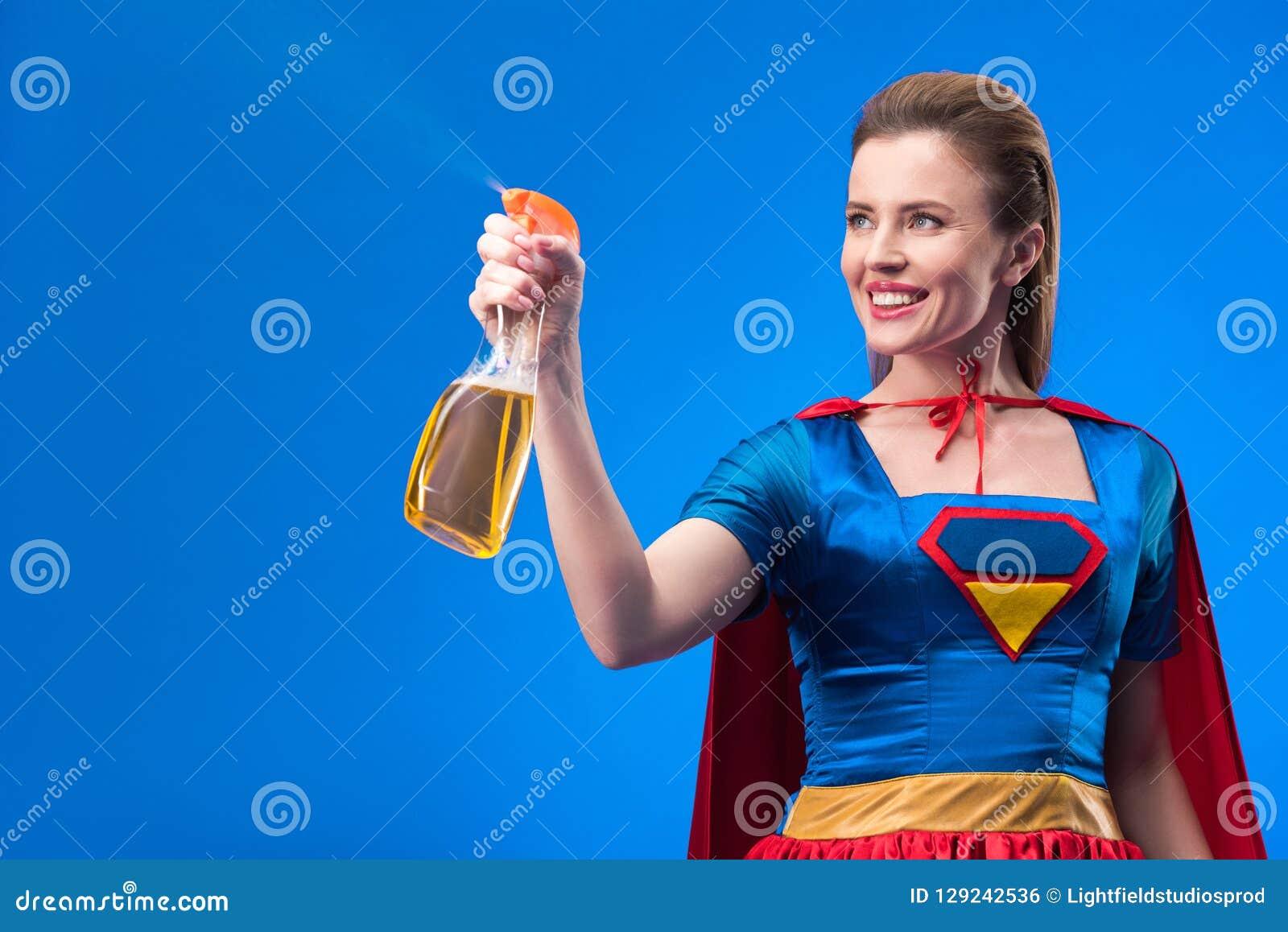 portrait of cheerful superwoman with detergent in hand