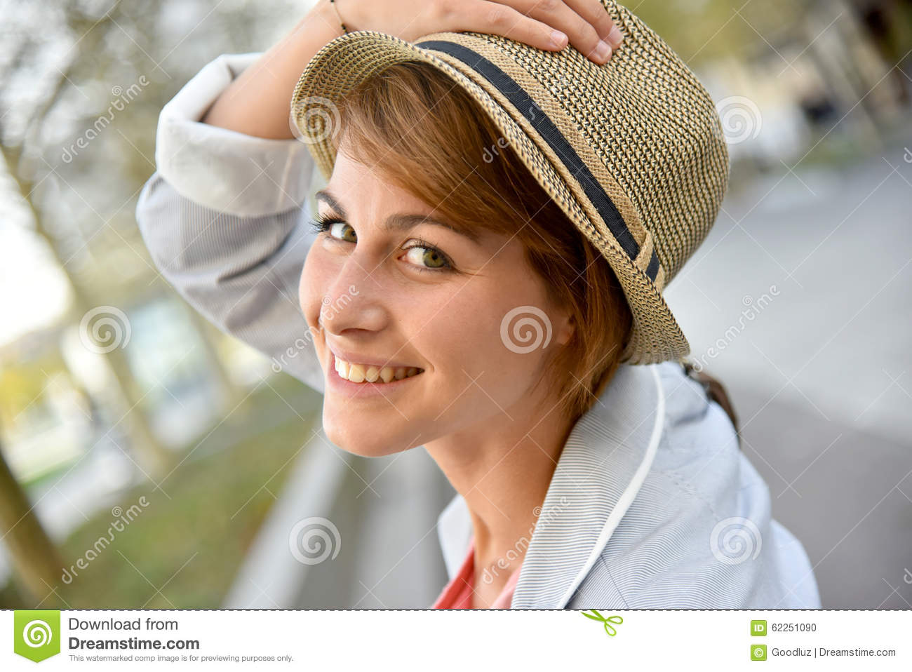 Portrait of cheerful young woman in town