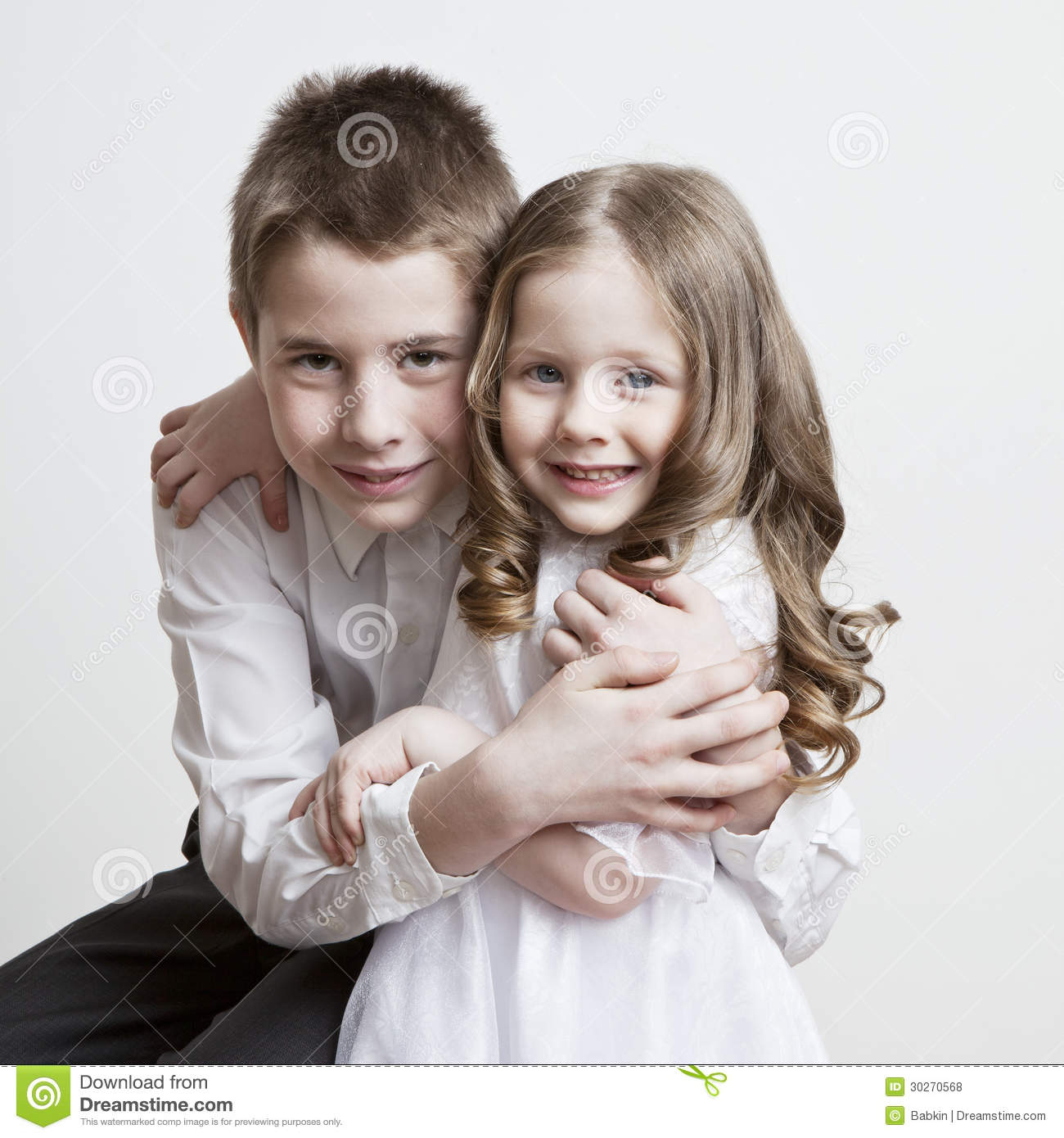 Portrait Of A Child The Love Of Brother And Sister In His Arms