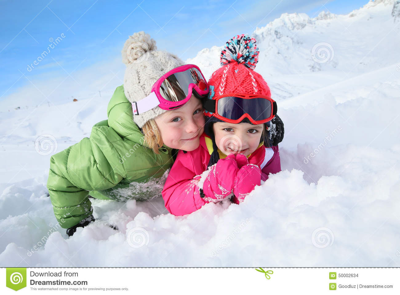 Portrait of children having fun in the snow stock photo for Vacation in the snow