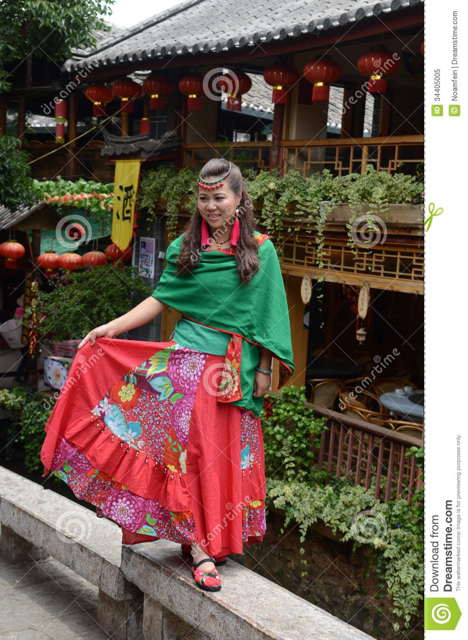 lijiang girls Asian chinese girls wears cheongsam enjoy holiday in lijiang ancient town  photo about adult, culture, attractivive, china, beautiful, classic, carefree, enjoy,.