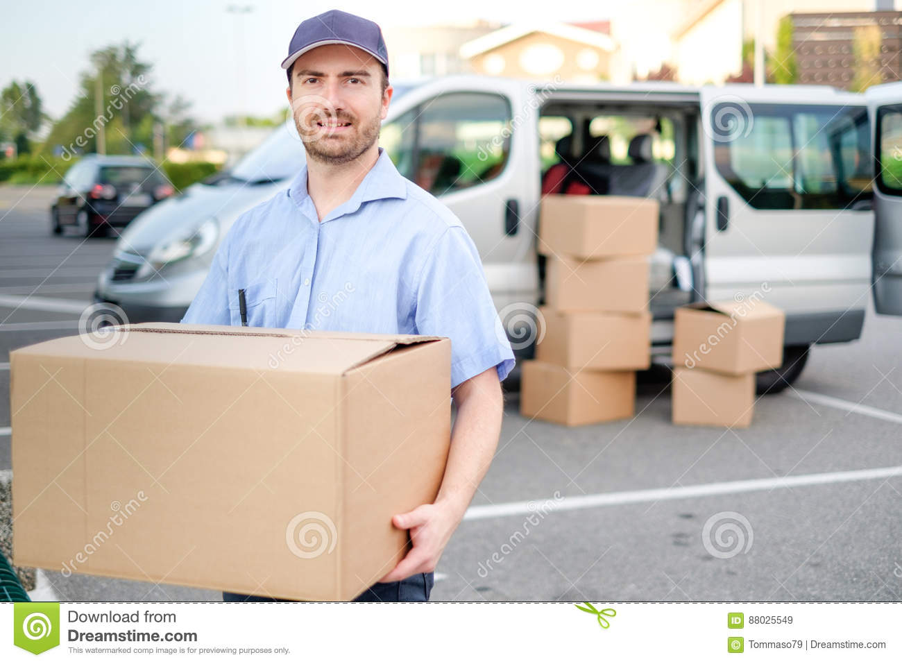 Portrait of confidence express courier and delivery van