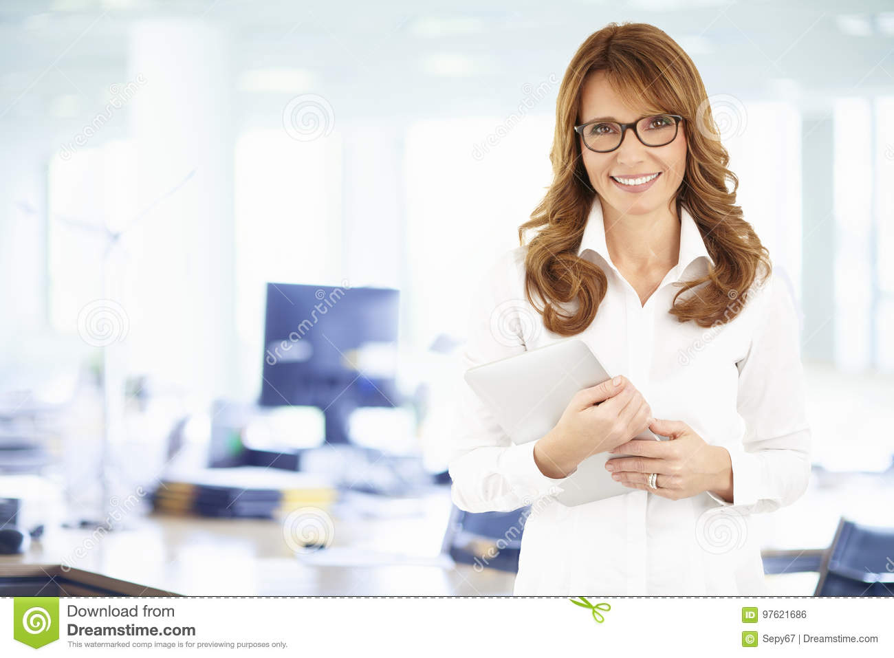 Portrait of confident business woman with digital tablet