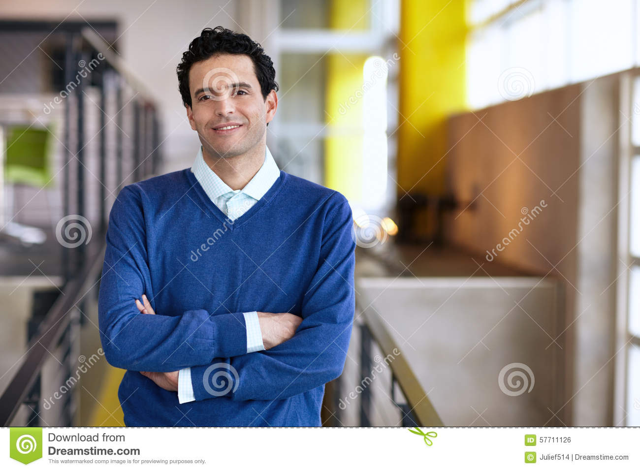 Portrait Of A Confident Businessman At Work In His Stock