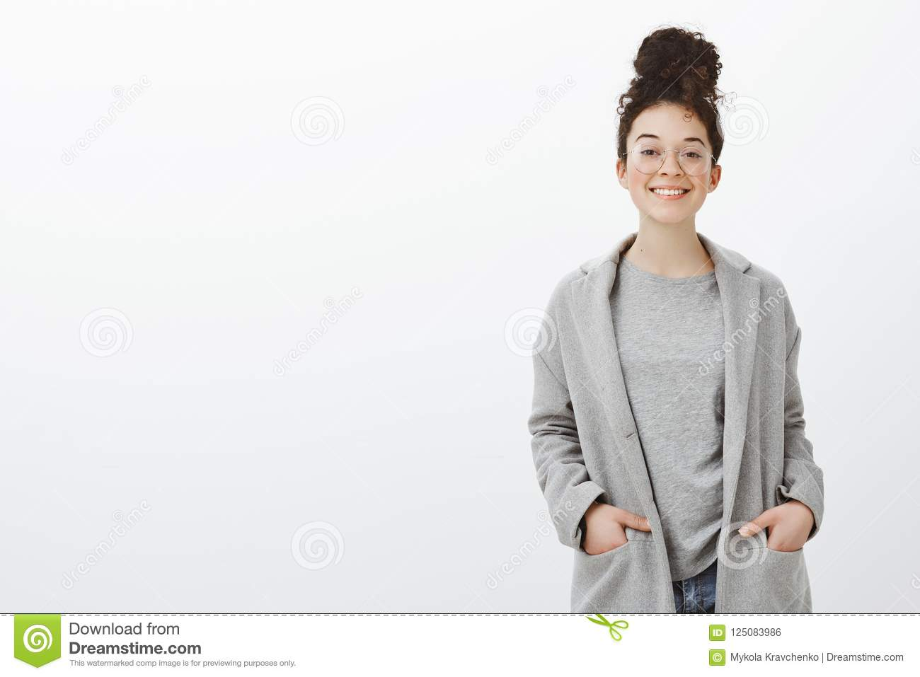 Portrait Of Confident Happy Good Looking Girl With Curly Hair Combed