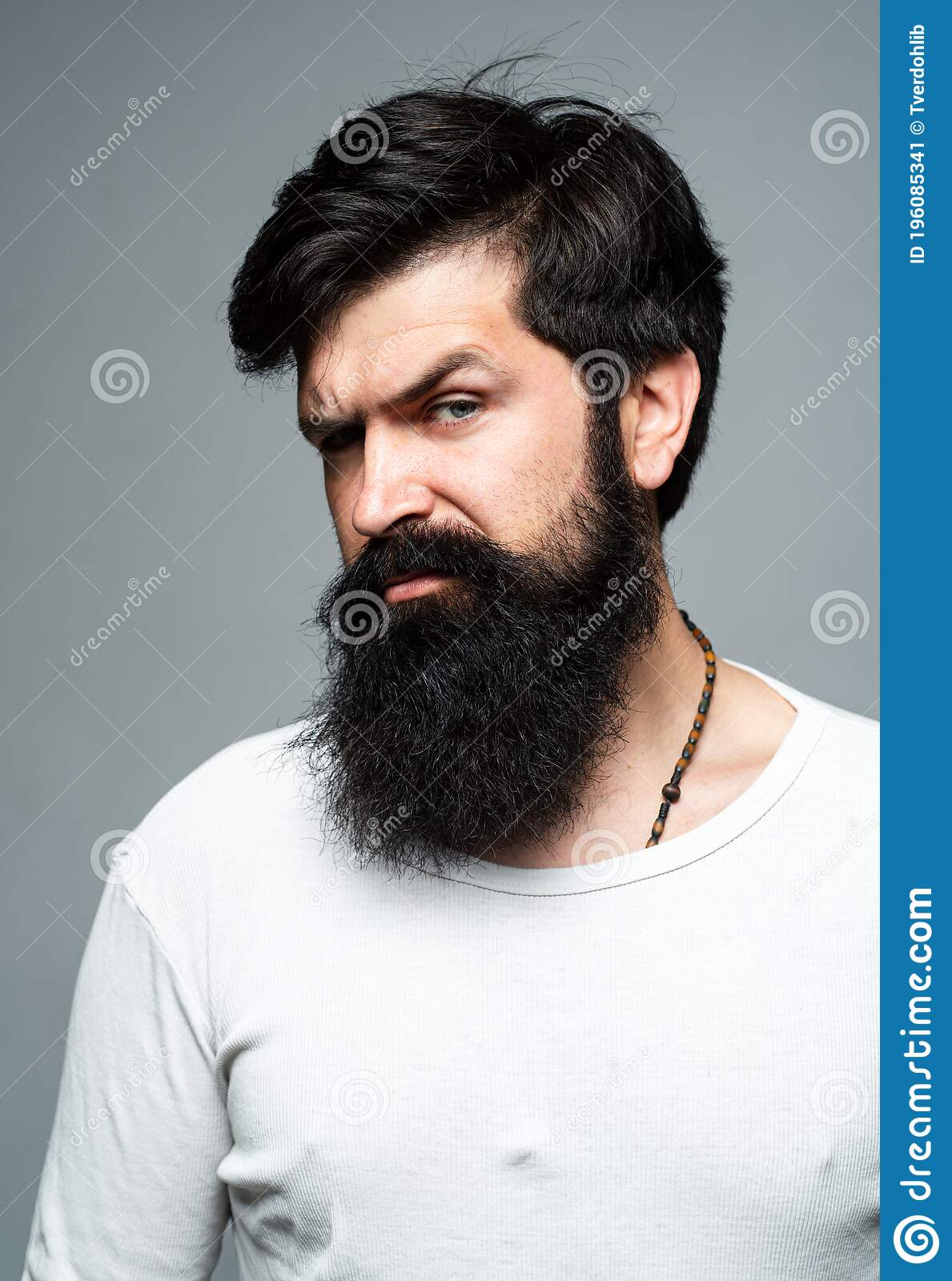Portrait Of Confident Serious Man Hipster Guy Models In Studio Handsome Male Model On Gray Background Stock Image Image Of Bearded Mens 196085341