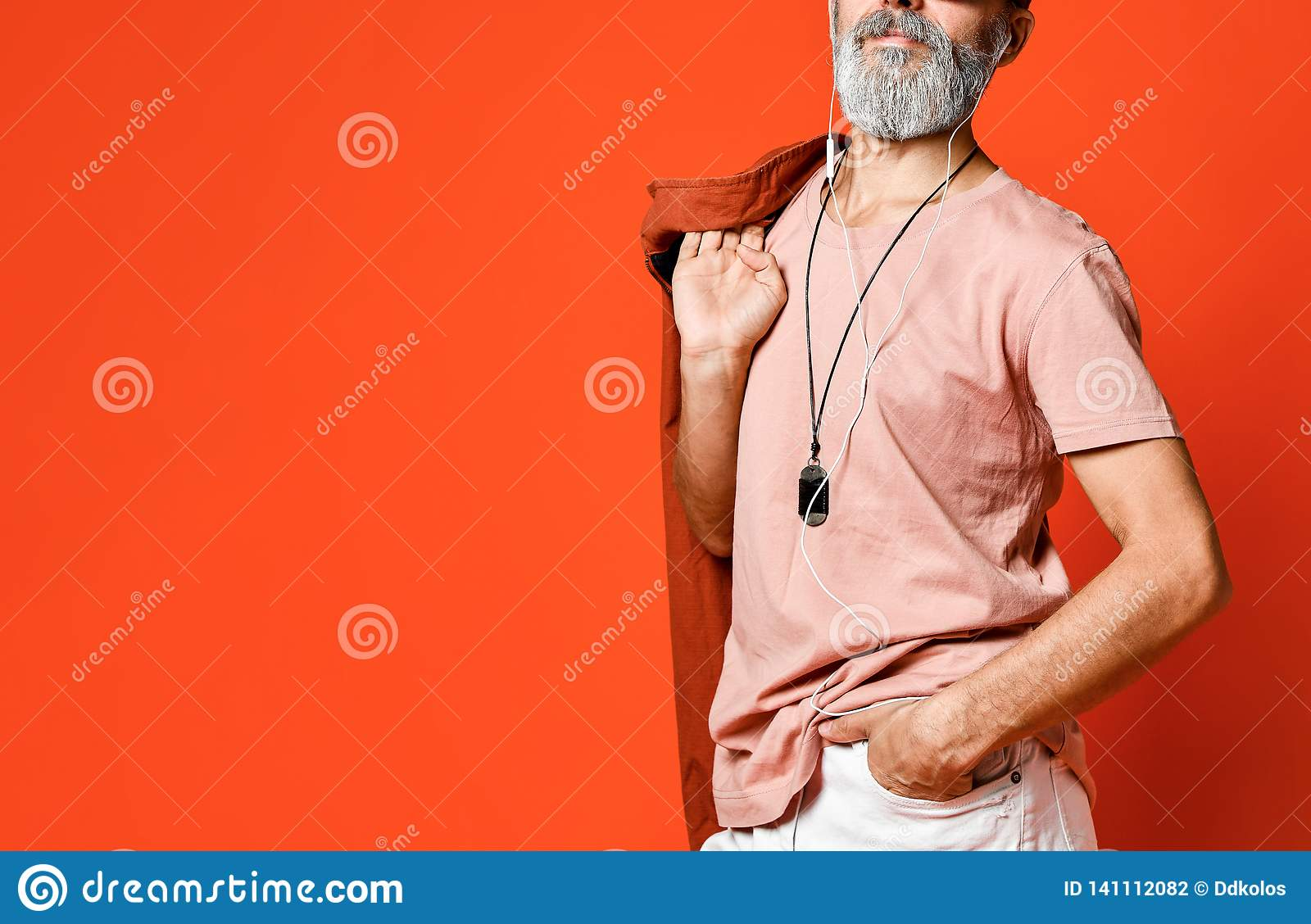 Portrait of cool, manly, fashionable old man holding hand in pocket , looking away camera in sunglasses