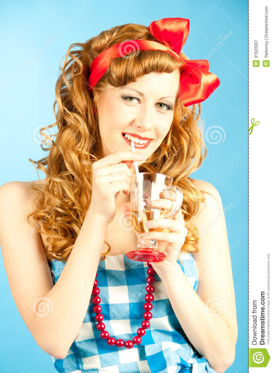 Portrait coquettish Lovely redhead pin-up girl drinks.