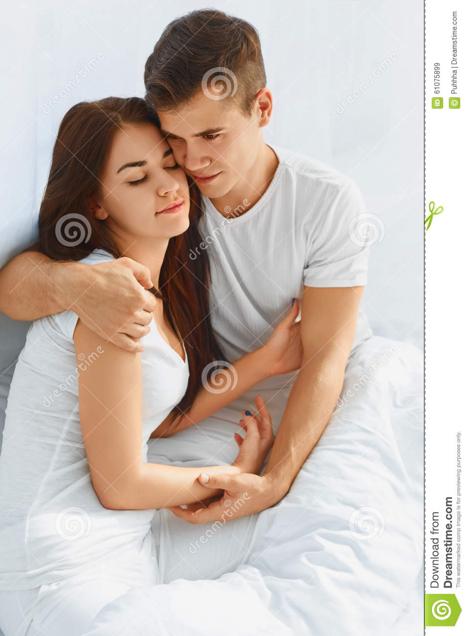 Man and woman in love in bed
