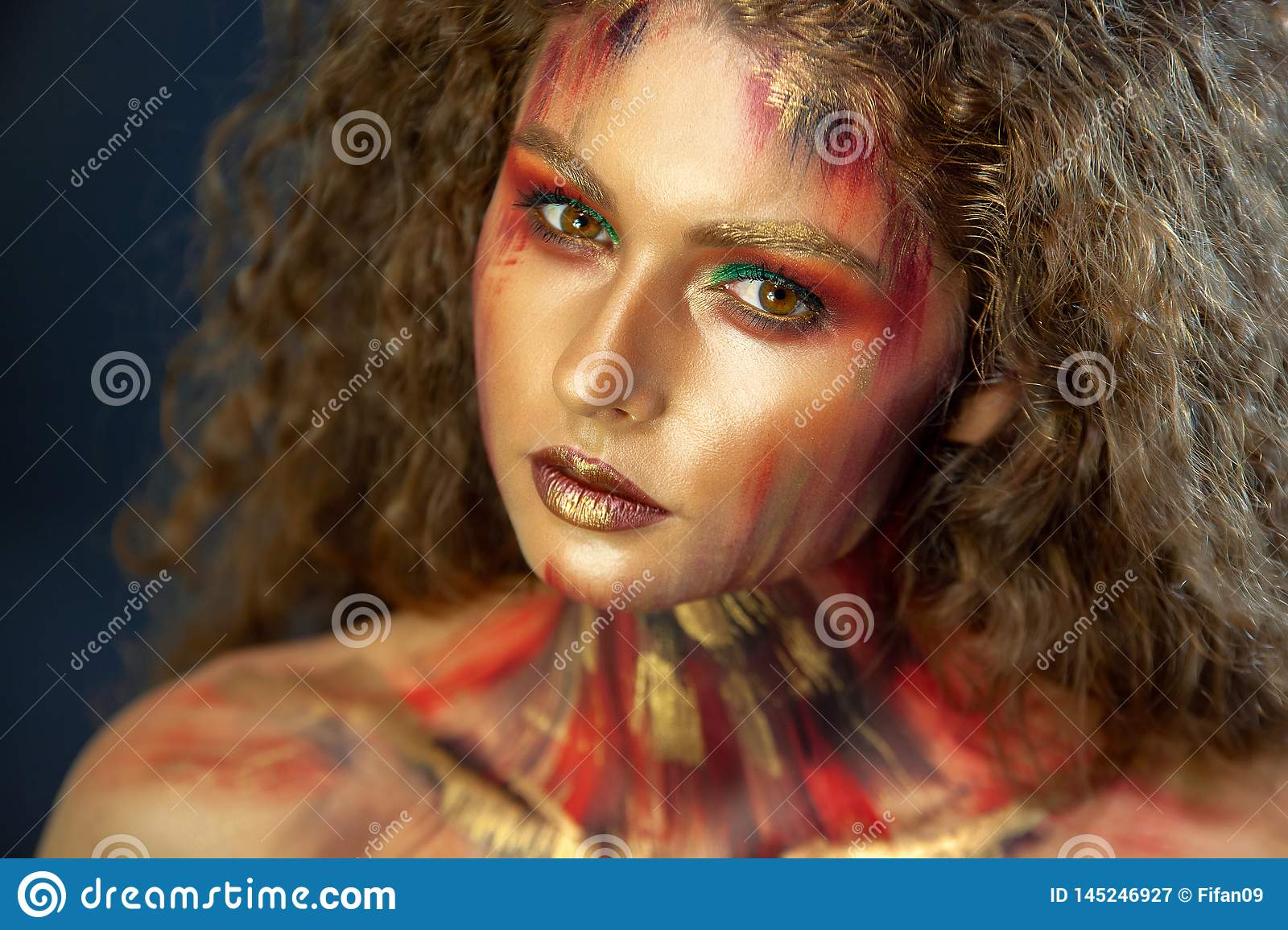 Portrait of curly girl with art makeup