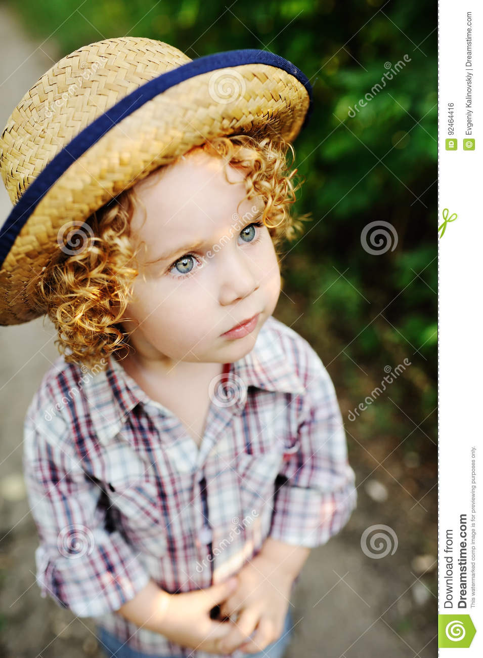 e3801ef96 Portrait Of Curly Red-haired Baby In A Hat. Stock Photo - Image of ...