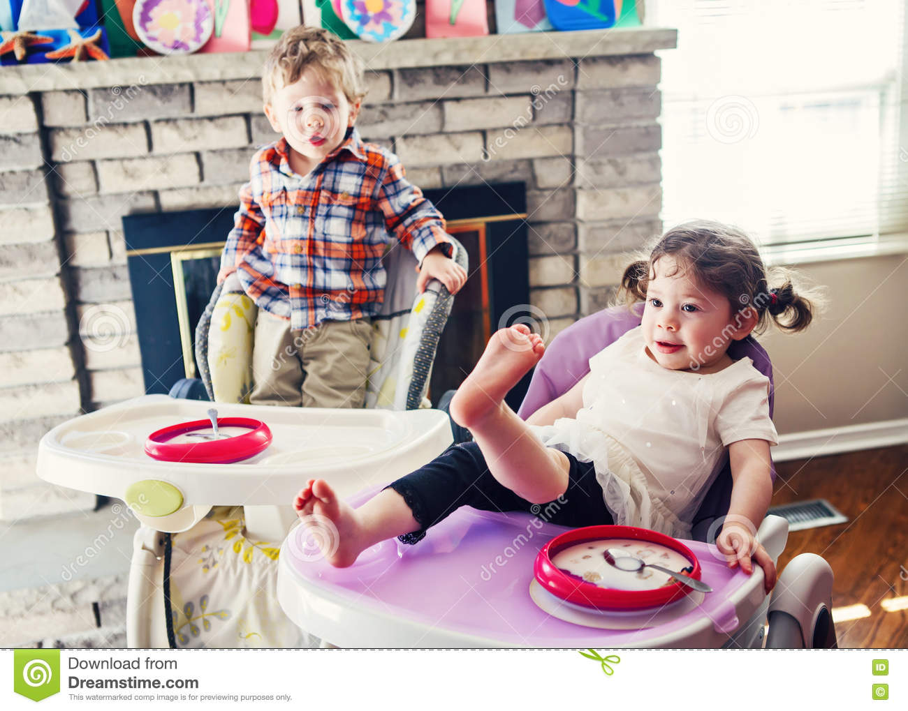 Portrait of cute adorable caucasian children twins for Toddler sitting chair