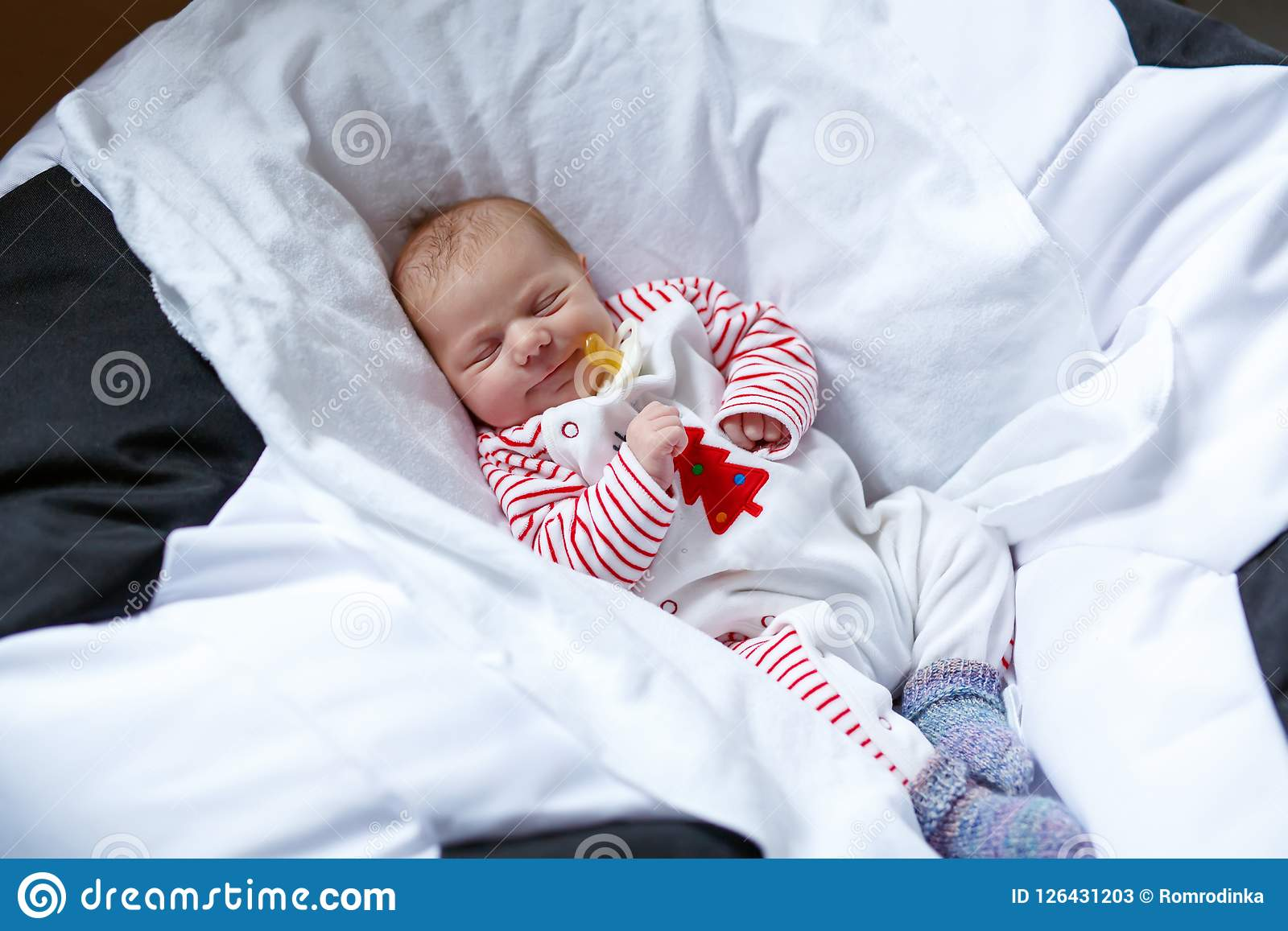585a74b35 Cute adorable newborn baby sleeping peaceful in bed. New born child, little  girl laying in bed. Family, new life, childhood, beginning concept.