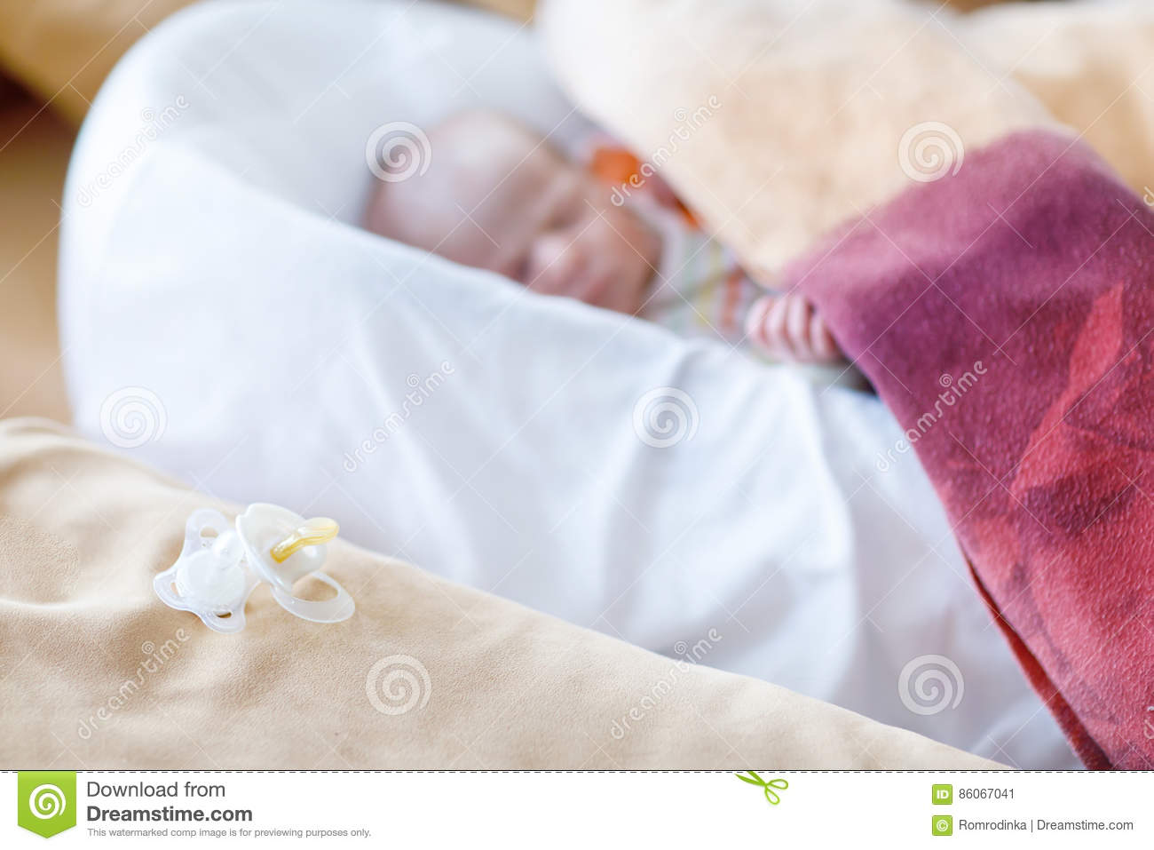 fa0945d4a Cute adorable newborn baby sleeping peaceful in bed. Focus on calm pacifier  or dummy. New born child, little girl laying in bed. Family, new life,  childhood ...