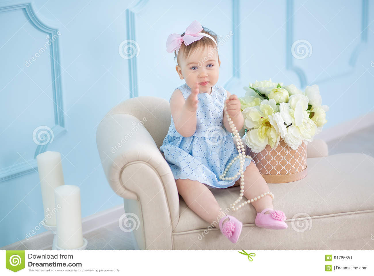 d5a75ea8f Portrait Of A Cute Baby Girl On A Light Background With A Wreath Of ...