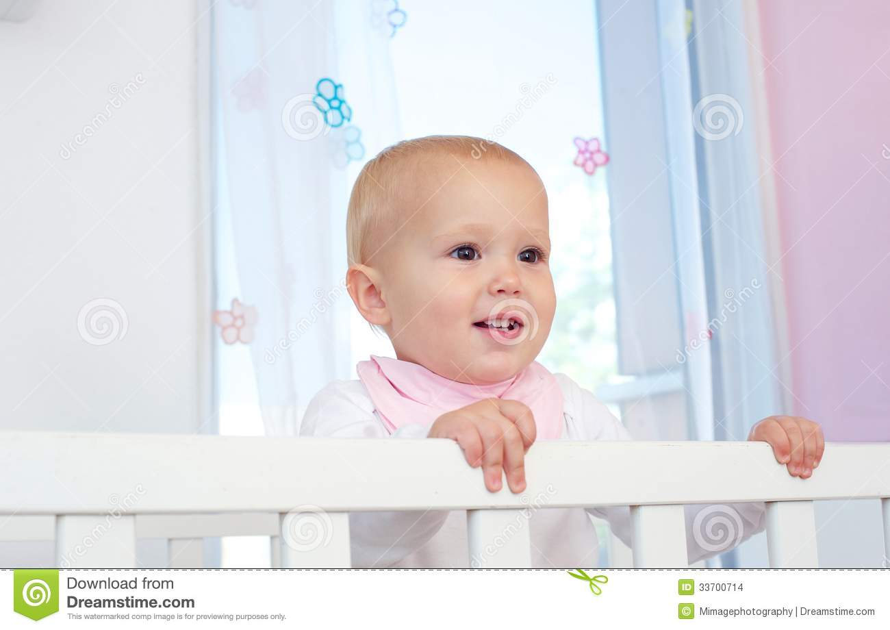 portrait of a cute baby smiling in crib stock images image 33700714
