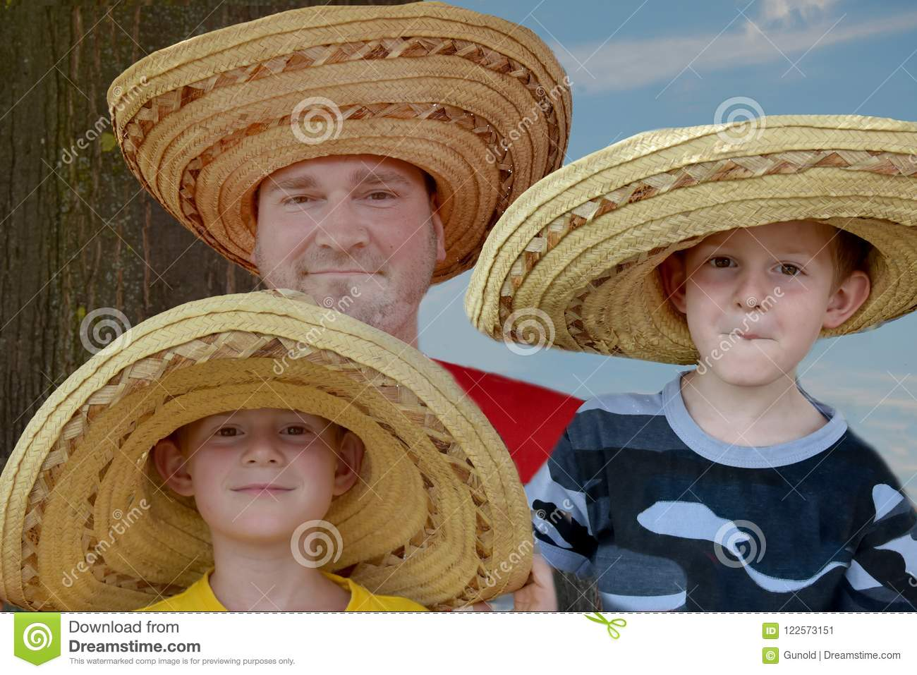 Father And His Two Sons With Big Mexican Straw Hats Stock