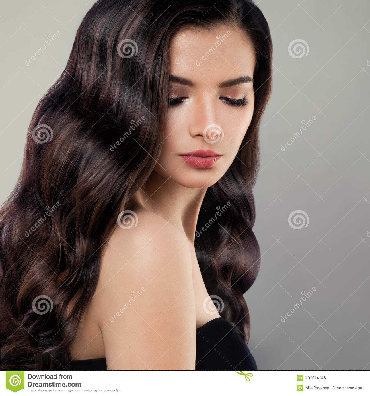 Portrait Of Cute Brunette Woman With Long Hair And Makeup Stock