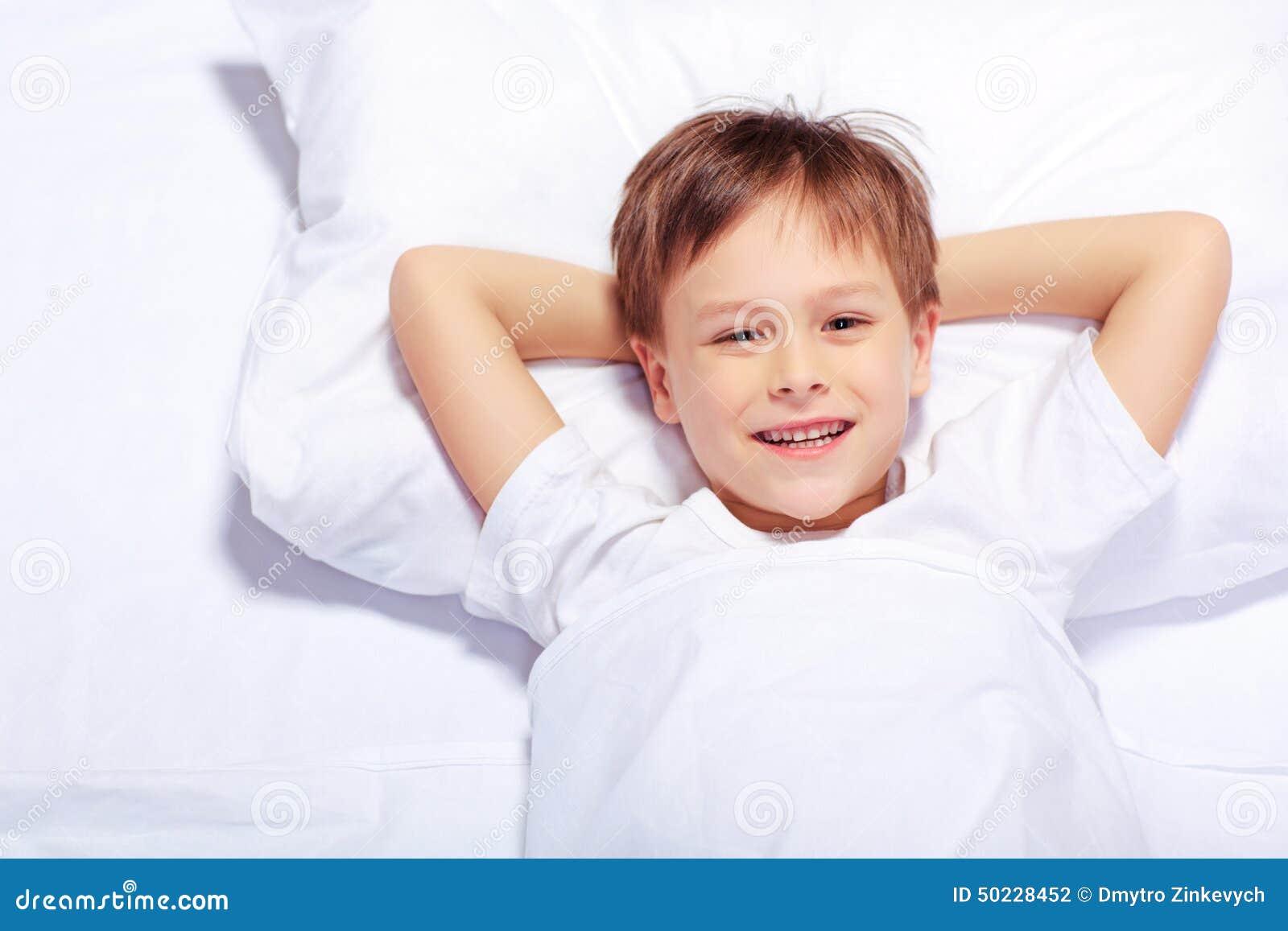Portrait Of A Cute Emotional Little Boy In Bed Stock Photo ...