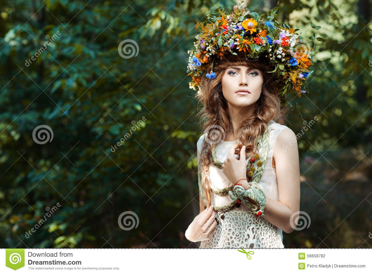 Portrait cute girl with wreath of flowers.