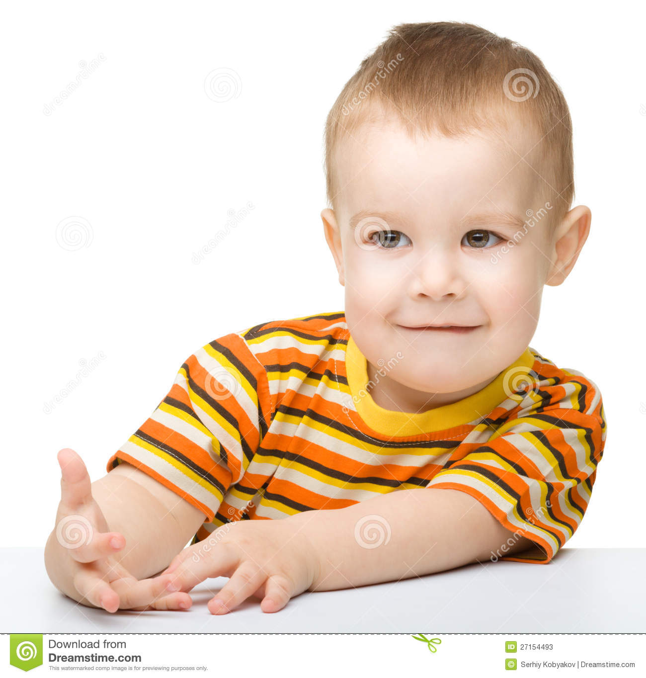 Portrait of a cute little boy looking at something