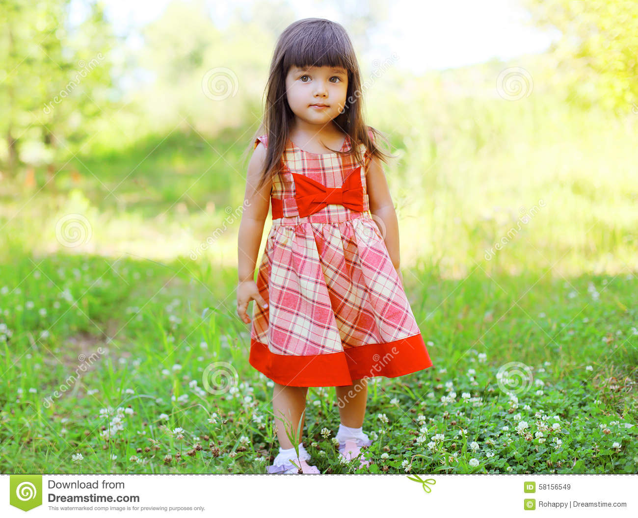 Portrait Of Cute Little Girl Child Wearing A Red Dress Stock Image