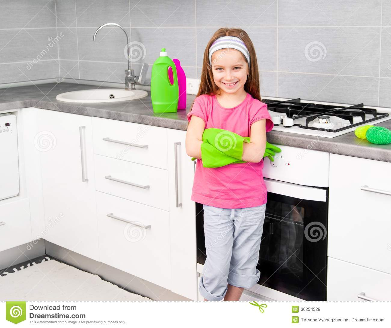Girl Make Cleaning In The Kitchen Stock Photo