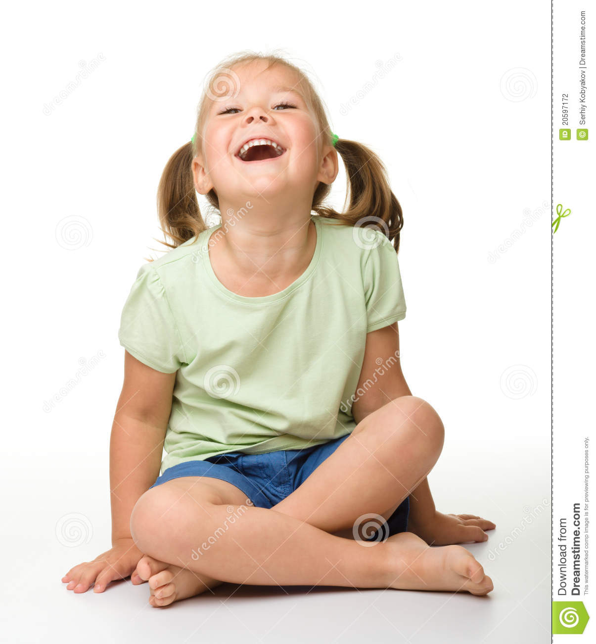 Portrait of a cute little girl laughing