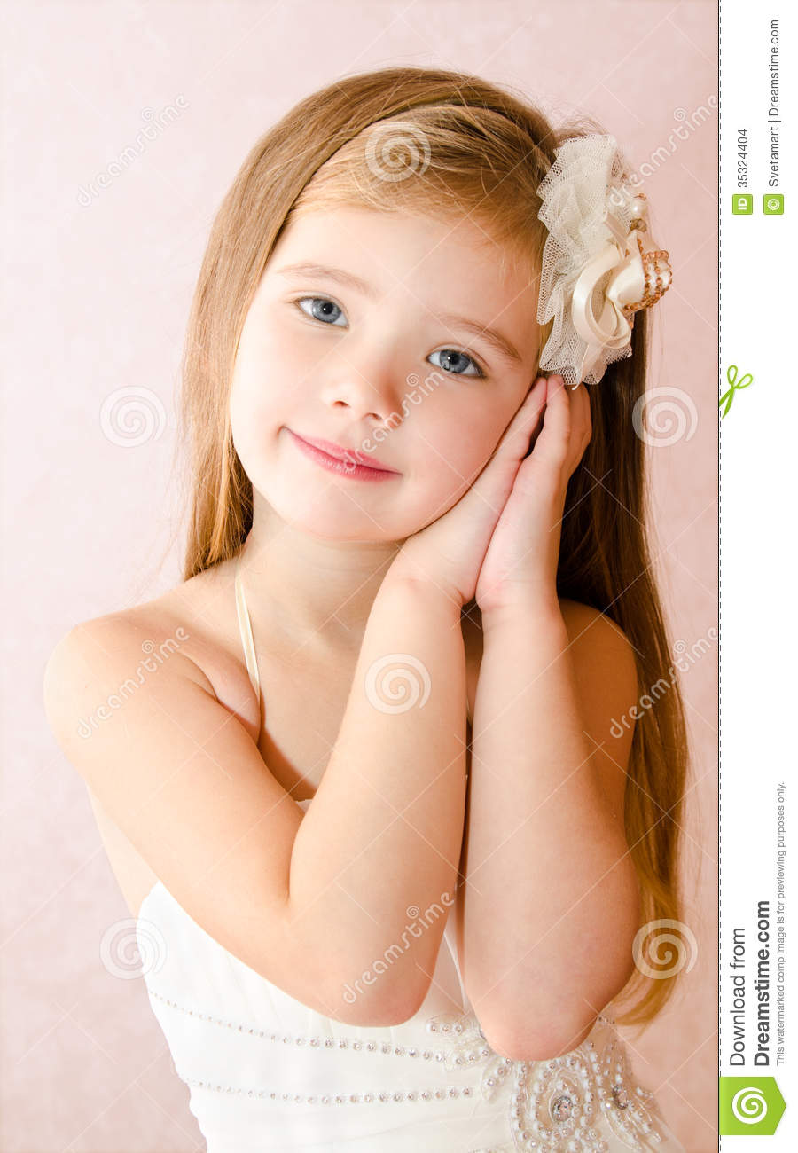 Portrait Of Cute Little Girl In Princess Dress Stock Photo