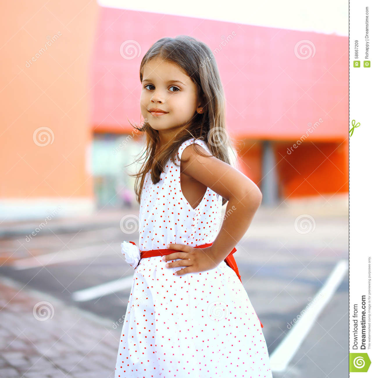 portrait of cute little girl wearing a dress stock image - image of