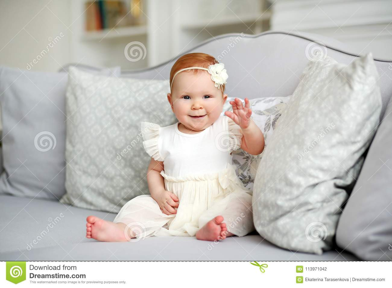 f26c4ef62 Portrait Of A Cute Smiling Little Girl In A White Dress In A Home ...