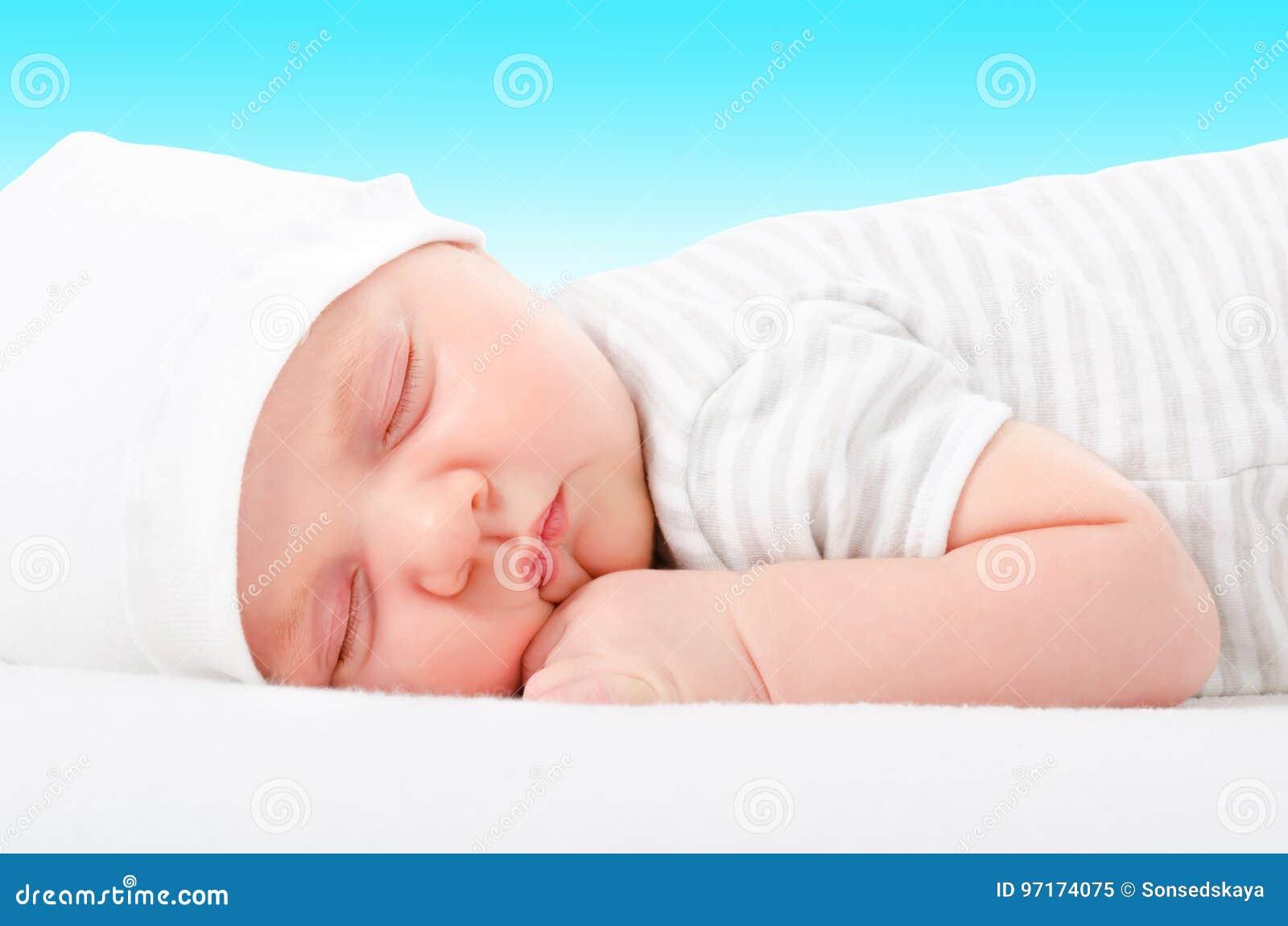 Portrait of a cute newborn sleeping baby