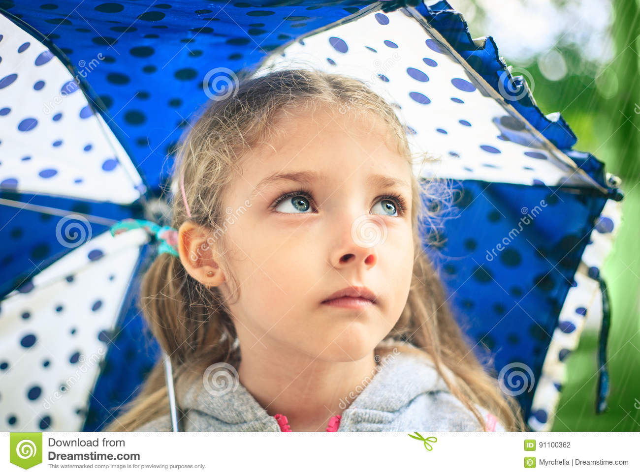 Portrait Of A Cute Sad Girl With An Umbrella. Stock Photo ...